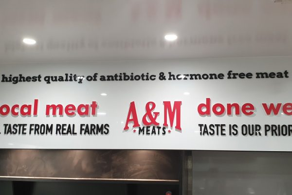 A&M Meats laser cut letters